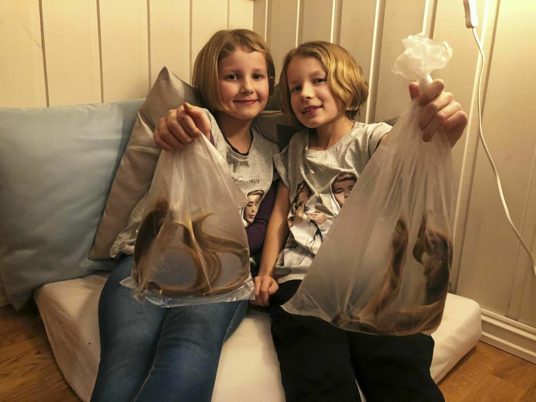 GIVERGLEDE: Søstrene Ida Kristine (til venstre) og Thea Sofie gir bort sitt lange hår for at syke barn kan få parykk.